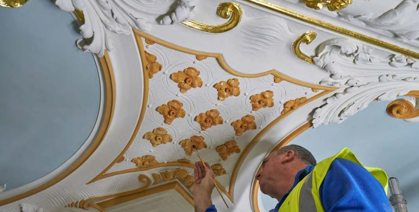 A gilder from Hare & Humphreys preparing the surface for gilding of the restoration to James Gibbs' Octagon Room ceiling, Orleans House.
