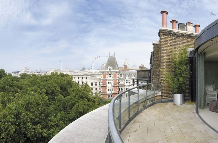 The new building works at roof level are unusual with its terrace and modern curved glass façade overlooking St James's Park.