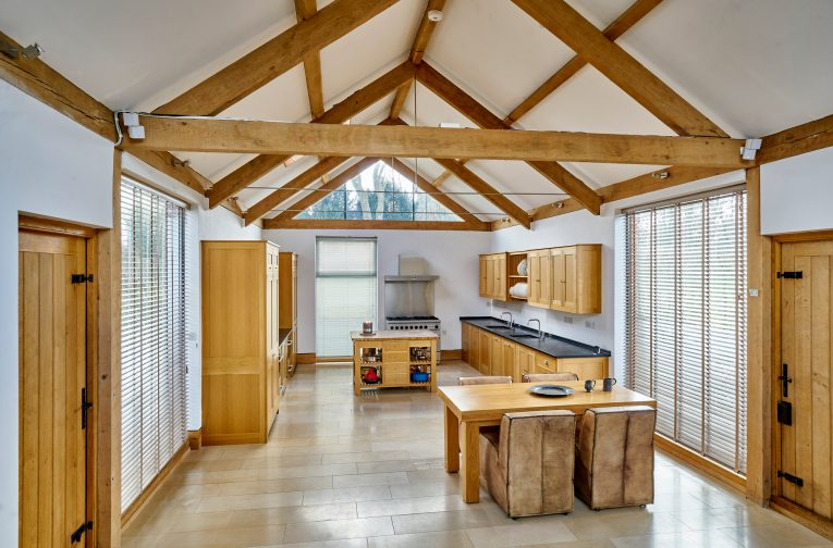 A contemporary new kitchen to Chevington Hall – a Grade II*, mid-16th century timber framed farmhouse in Suffolk, which stands on a moated site of a 13th-century retreat house.