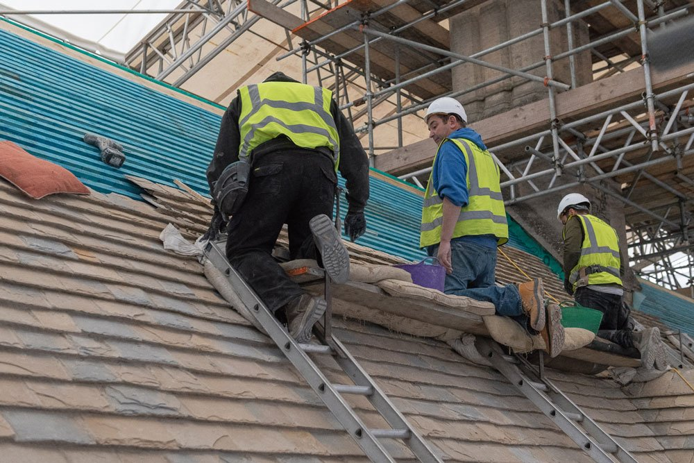 Roofers at work reroofing Bodley's Court