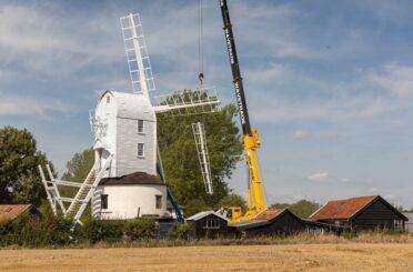 Saxtead Green Post Mill from across a farmer's field