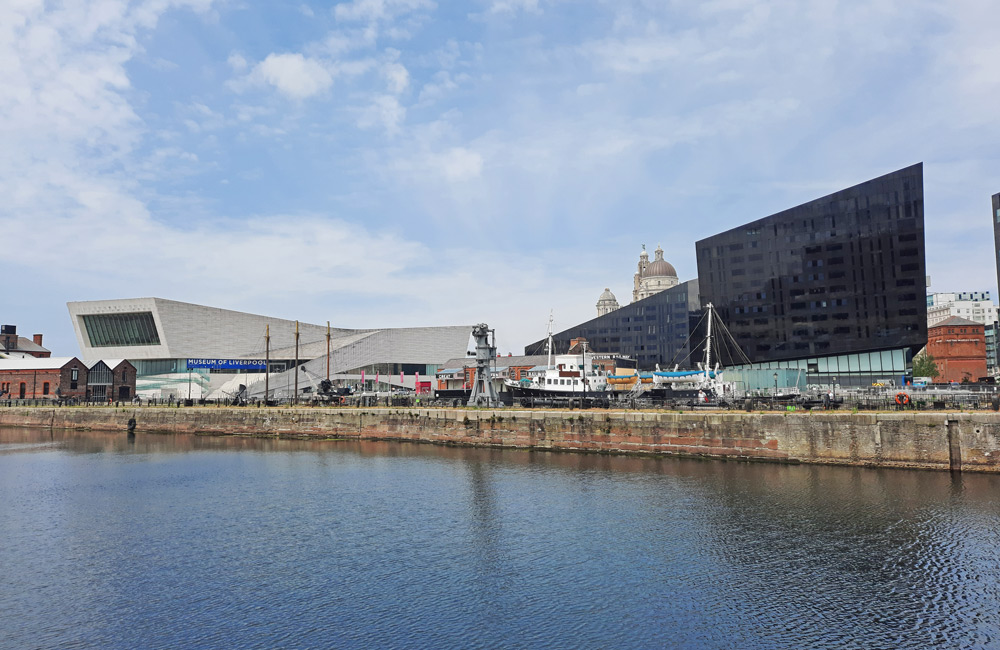 Liverpool's waterfront with two large modern buildings on the line of the dock
